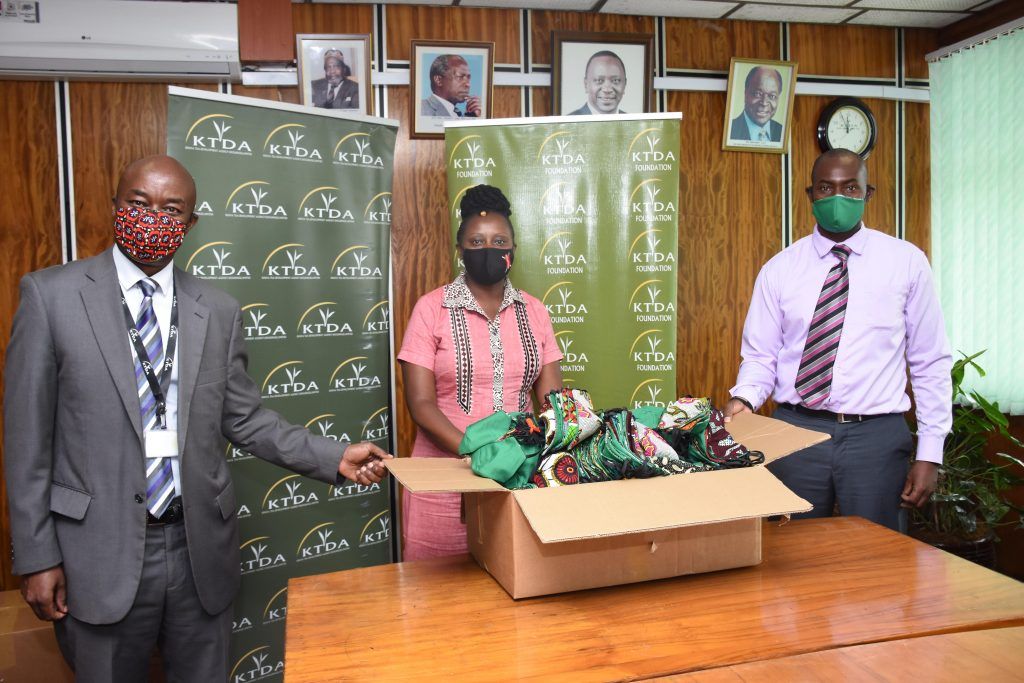 KTDA MS Operations Director Alfred Njagi left and KTDA Foundation Manager Sudi Matara right receive a donation of protective masks from Nyambura Magochi Ethical Tea Partnership Africa min