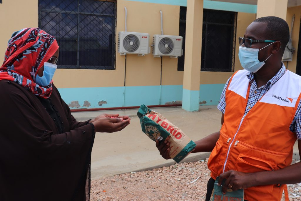 Mwanajuma Hiribae the Tana River County Executive Committe Member CEC for Agriculture receives samples of the seeds from World Vision.©World Vision Photo.