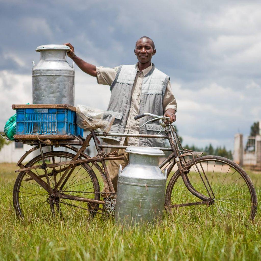 Farmer transporting milk in Kenya