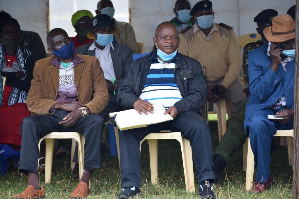 Coffee farmers follow the meeting proceedings